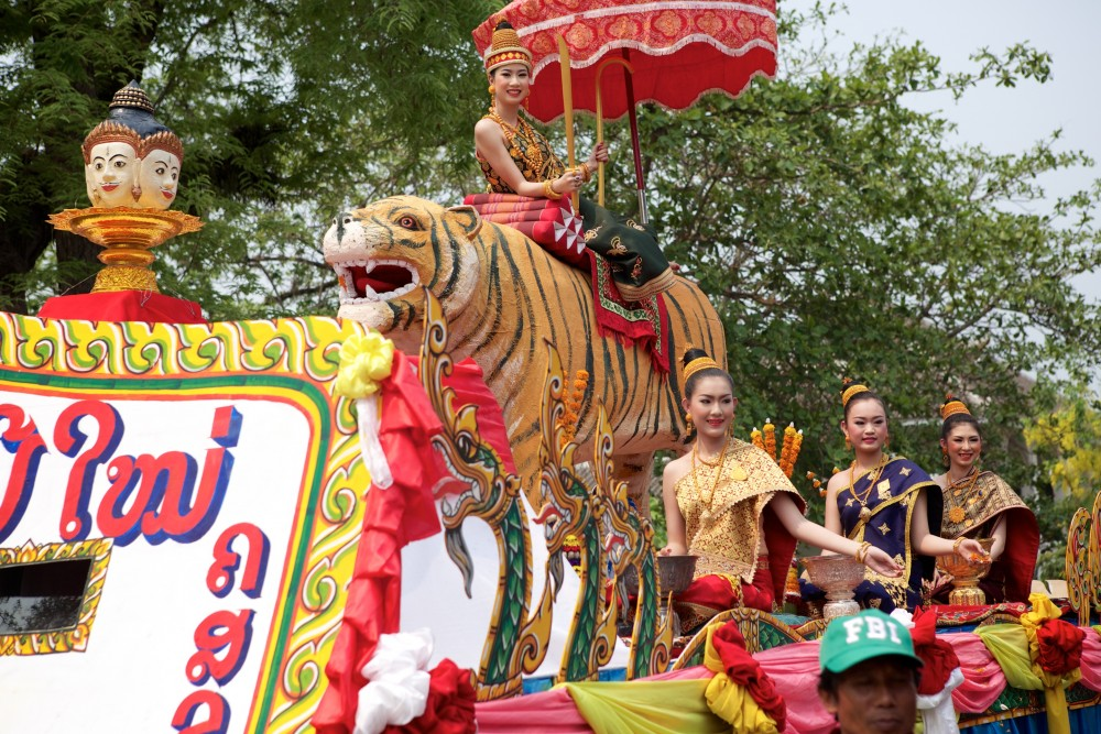 Miss Lao beauty pageant contestants on colorfultiger float at Laos New Year parade in Luang Prabang