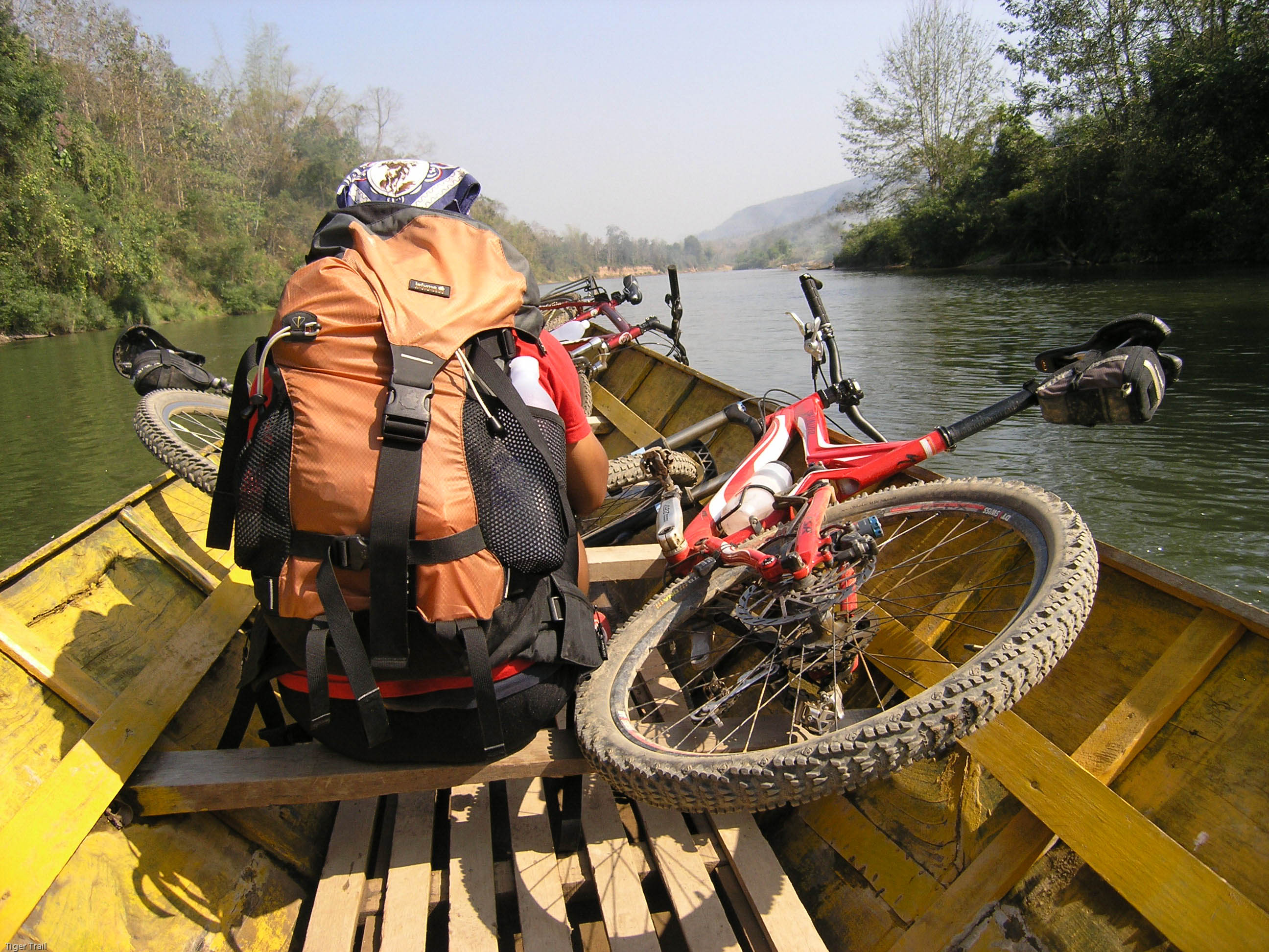 Mountain biking around Laos villages, mountains, and rivers