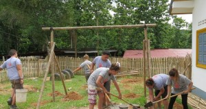 volunteers in laos build bamboo playground