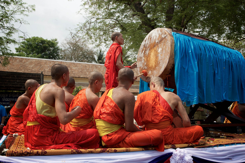 Group of young monks sit on float in Lao New Year Pi Mai Lao Parade in Luang Prabang