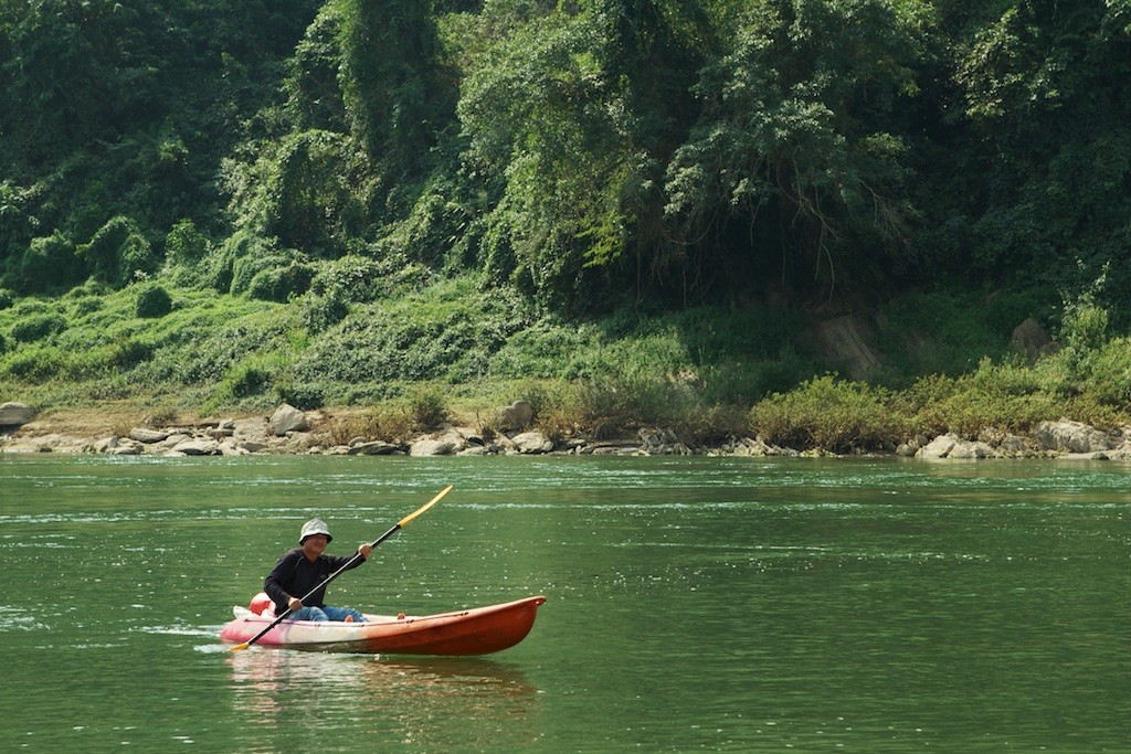 Luang-Prabang-Nam-Ou-River-Kayaker-Photo-By-Kyle-Wagner