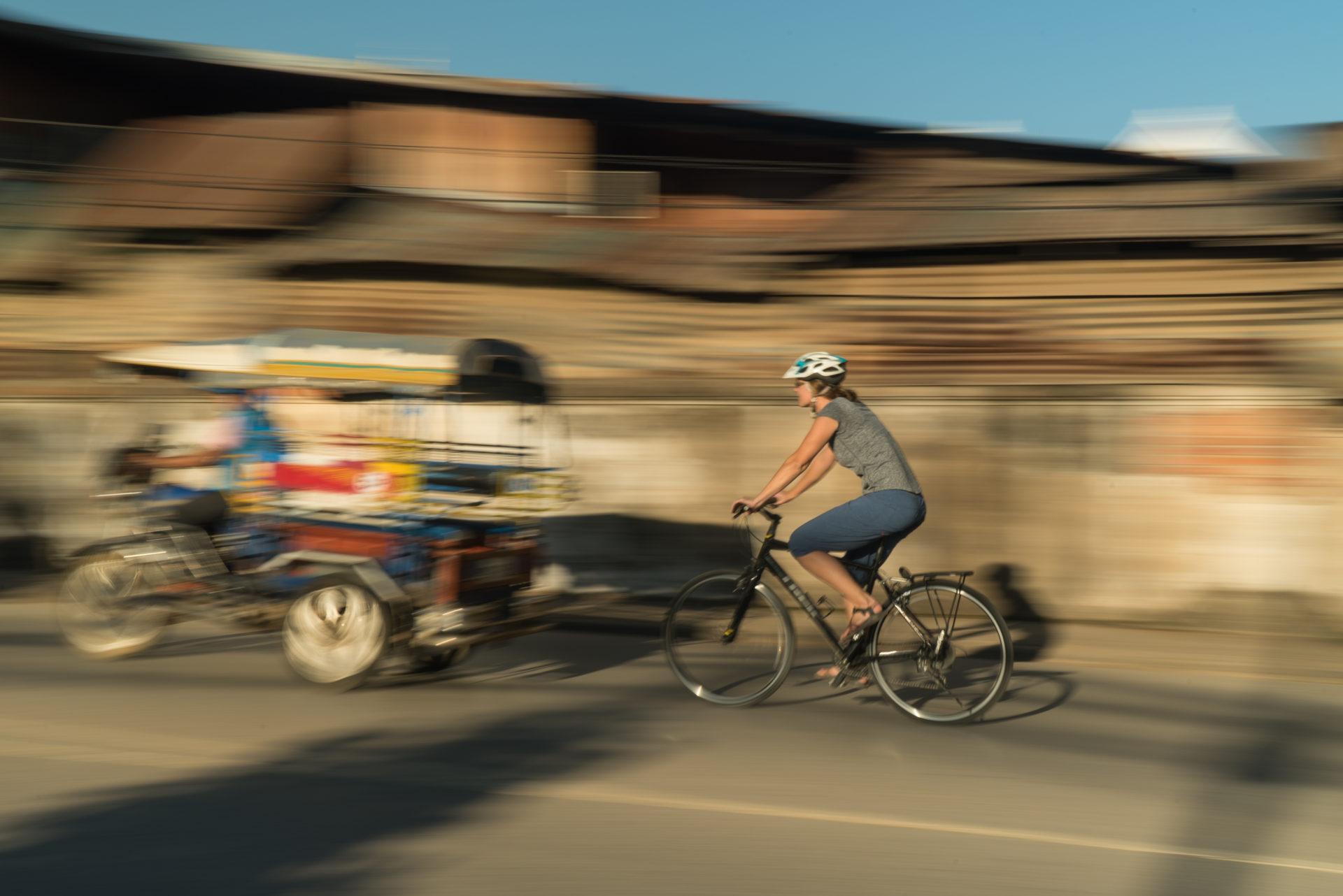 laos-cycling-biking-bike-ride-luang-prabang-city-tuk-tuk-taxi-southeast-asia-travel-adventure