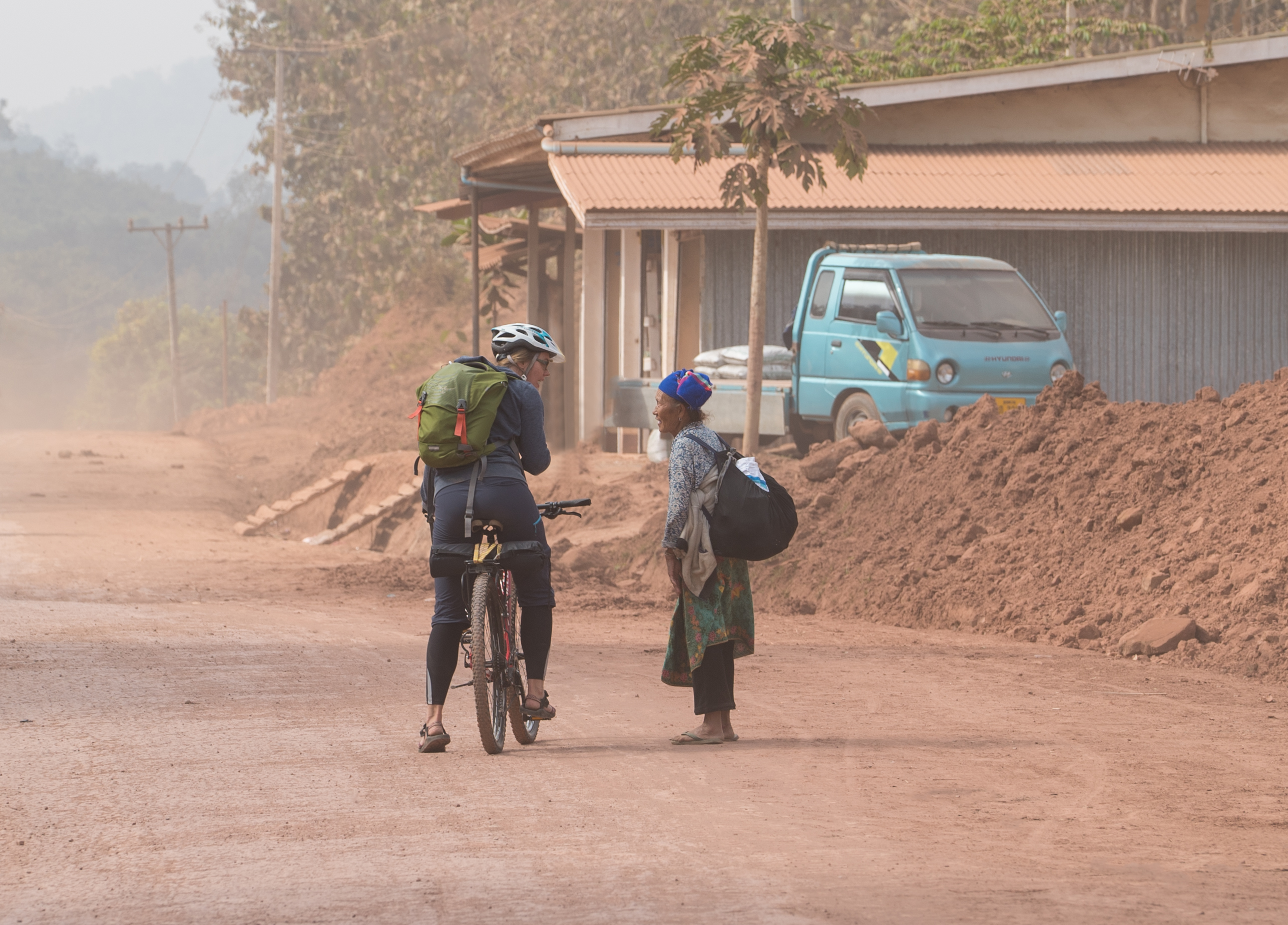 laos-biking-bicycle-cycling-lao-pdr-dirt-road-local-villager