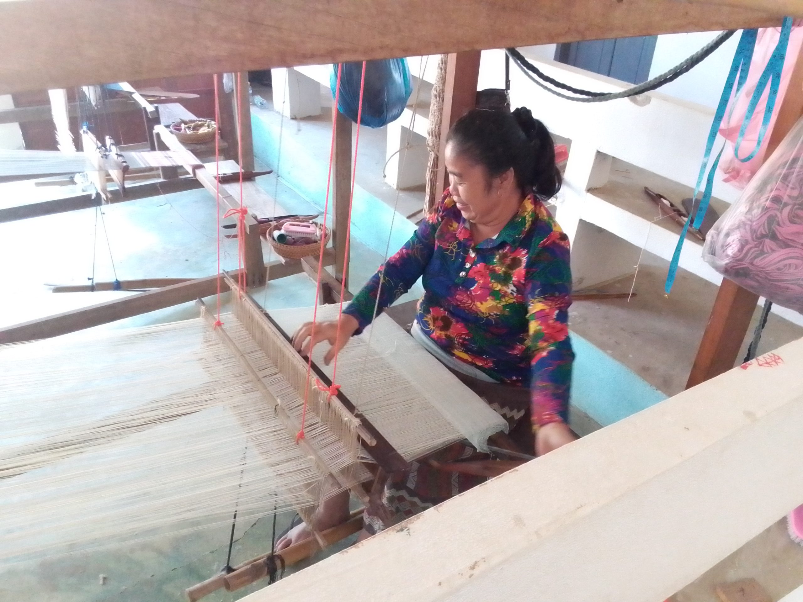 Instructor demonstrating floor loom use, Luang Prabang Deaf & Mute Community Training Centre
