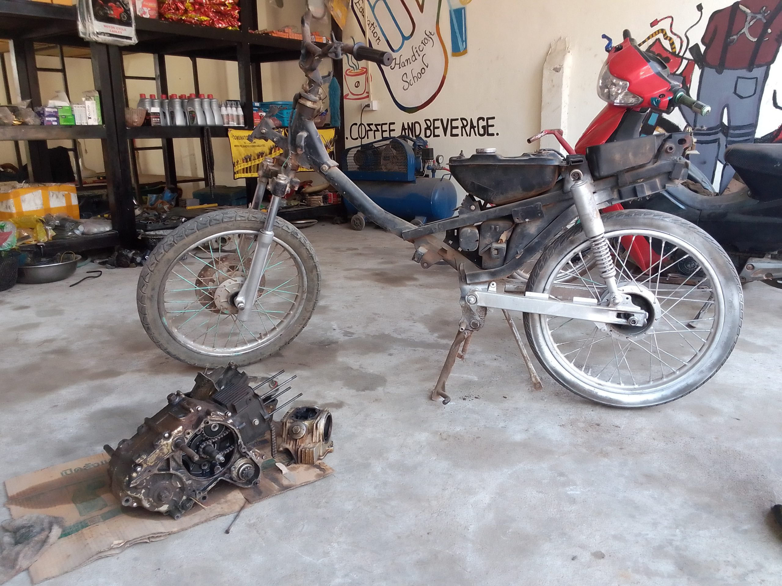 Stripped down moto, engine on the floor, Luang Prabang Deaf & Mute Community Training Centre