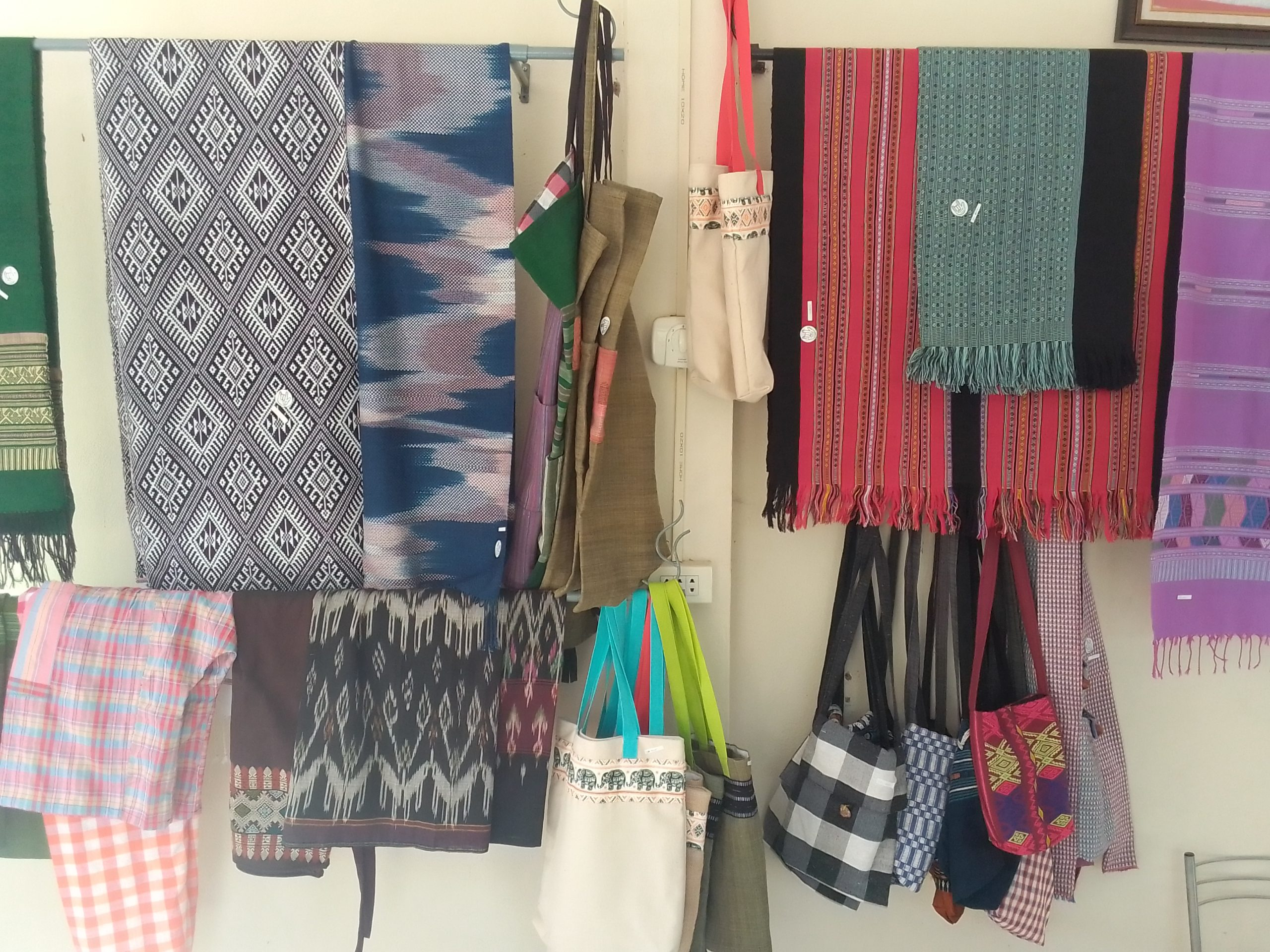 Finished products for sale include scarves & purses, Luang Prabang Deaf & Mute Community Training Centre
