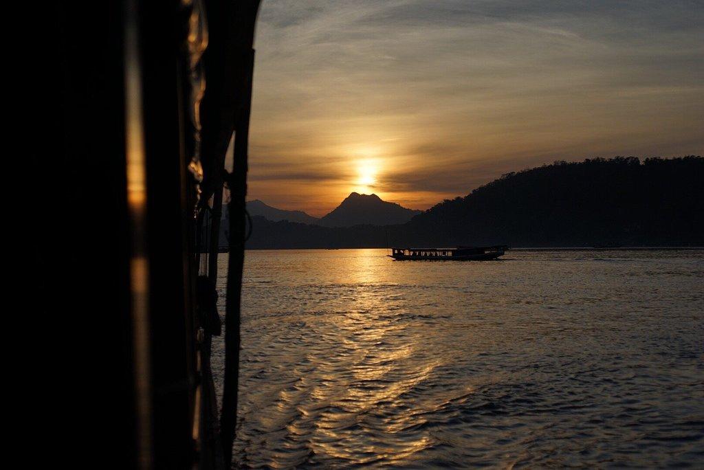 Experience Golden hour on-board Luang Prabang's Nava Mekong Sunset Cruise.